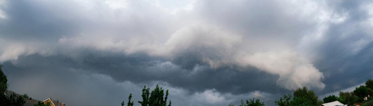 Extreme thunderstorm shelf cloud. Summer landscape of severe weather