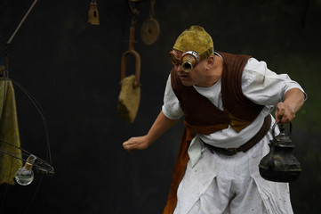 A man dressed as an alchemist demonstrates chemical tricks during a medieval combat festival at Claregalway castle in Galway