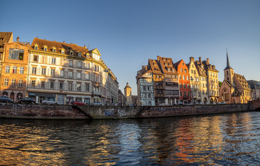 View along the Ill River in historic areas of Strasbourg in the Alsace region of France.