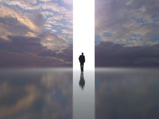 man stands near a light portal