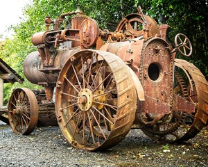 This old rusty tractor must have worked quite a bit through the ears before being retired  and become  relic.