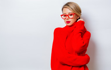 Portrait of a beautiful white woman in red sweater on white background, isolated.