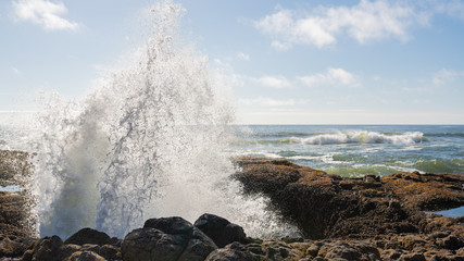 Water erupting out of Thor's Well, landmark hole in the ground located on the Oregon coast.