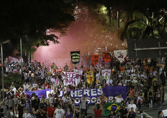 People march during a demonstration against Brazil's presidential candidate Jair Bolsonaro, in Sao Paulo, Brazil