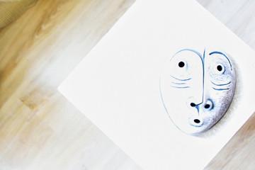 White mask on white background