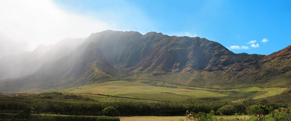 Panoramic landscape of Beautiful valley with misty rain and blue sky