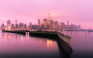 Manhattan Skyline before sunrise with fog, New York City, USA
