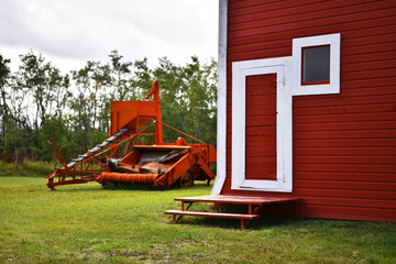 Vintage Combine Harvester and Red Barn