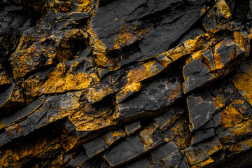 black rock background with gold  / yellow colored rocks