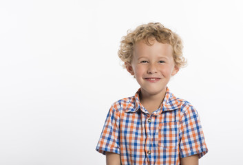 Giggling little boy in plaid shirt, isolated on white background