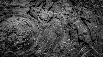 dark rock wall background - stone texture with onion skin weathering