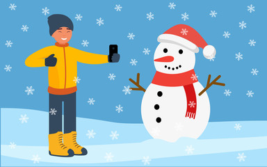 Happy man with a smartphone, takes a picture of a snowman on the background of a winter landscape with falling snowflakes. Flat design. Vector illustration.