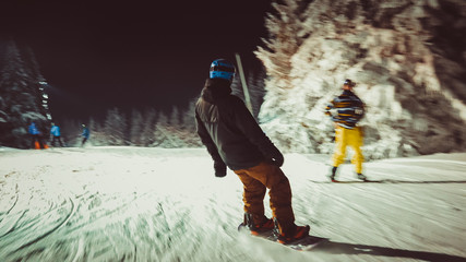 Adventure snowboarder on mountain