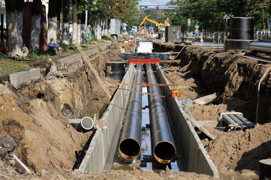 Replacement pipes in the city.Construction of heating mains for municipal infrastructure, the concept of city development.