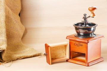 Old fashion wooden coffee grinder scene.