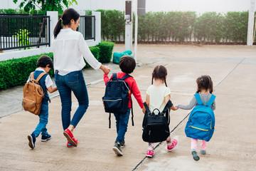 Family children kid son girl and boy kindergarten walking going to school