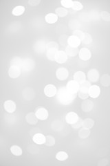 Elegant Abstract Silver Christmas Background with white bokeh lights for Holiday Poster, Banner,...