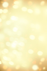 Golden Christmas  bokeh background with snowflake and gold  glittering bokeh stars. A shiny holiday...