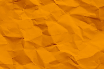 Orange background and wallpaper by crumpled paper texture and free space.