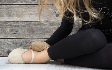 closeup of a beautiful slim gymnast ,wooden floor background, with copy space.