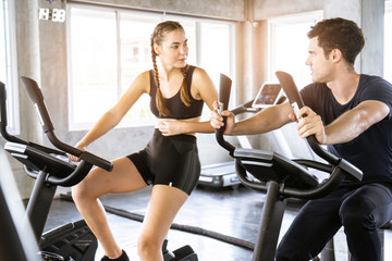 Fitness woman working out on exercise bike at the gym.fitness and healthy lifestyle.h machine aerobic for slim and firm healthy muscles lifestyle.
