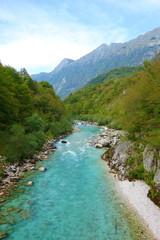 Foto op Aluminium Rivier Velika Korita or Great canyon of Soca river, Bovec, Slovenia. Beautiful vivid turquoise river stream rapids, running through canyon a forest. Soca river, Triglav National Park, Julian Alps, Slovenia