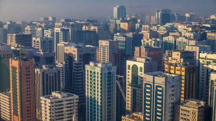 Skylines under the thick fog at the street timelapse of Abu Dhabi at morning
