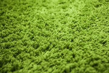 Close up of green yarn carpet for background