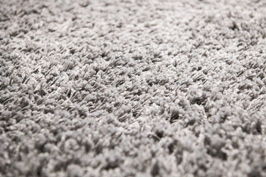 White carpet background texture, close up, gray textile texture, fluffy rug background, Wool fabric texture, beige hairy carpet, fragment shaggy mat, interior, material with pattern abstract.