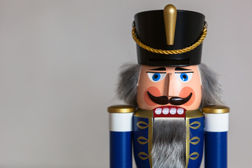 Close-up of a handmade wooden Nutcracker Figurine - Soldier in blue Uniform, a typical Christmas Decoration
