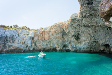Apulia, Grotta Zinzulusa - A motorboat at the famous grotto of Zinzulusa