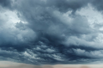 Storm clouds with contrast between dark gray and white that threaten a heavy rain. copy space