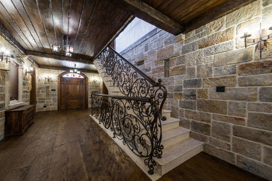 Stairs with wrought iron in luxury home celler