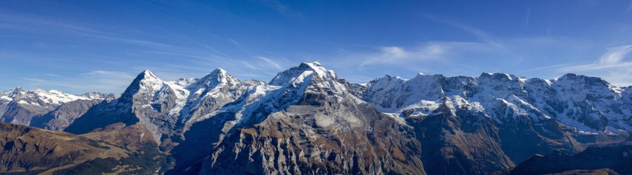 The famous three peaks and its extension: Eiger, Mönch und Jungfrau, and Gletscherhorn, Ebnifluh, Mittags-, Gross- und Breithorn in Berne Alps, Switzerland