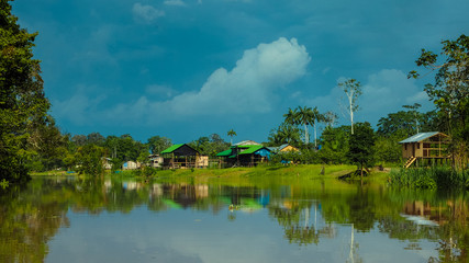 remote village houses at the amazonas river in peru
