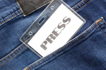 Blue jeans detail with press badge