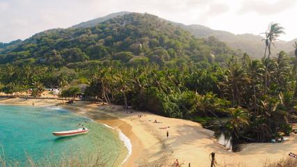 tropical beach with turquoise water at tayrona natural park