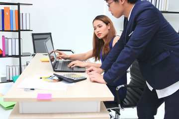Young Asian business people working together in office.