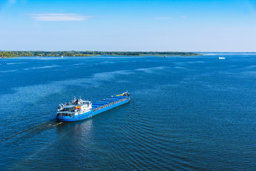 Cargo ship sailing on the sea or river