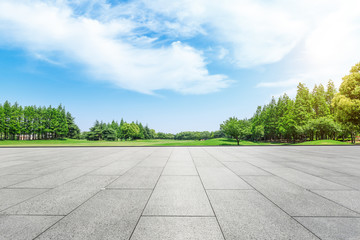 Empty square floor and green forest natural scenery in the city park Wall mural