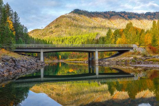 McDonald Creek bridge in autumn colors, Glacier National Park, Montana