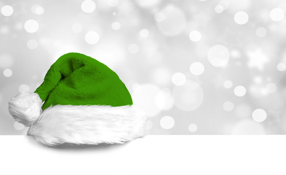 Green Christmas Cap on white Board