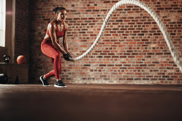 Woman doing cross training routine