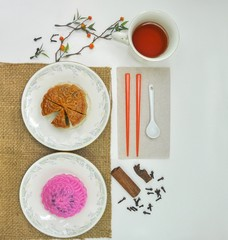 Mid autumn festival moon cake and hot tea isolated on white background. Chinese mid autumn festival food concept.