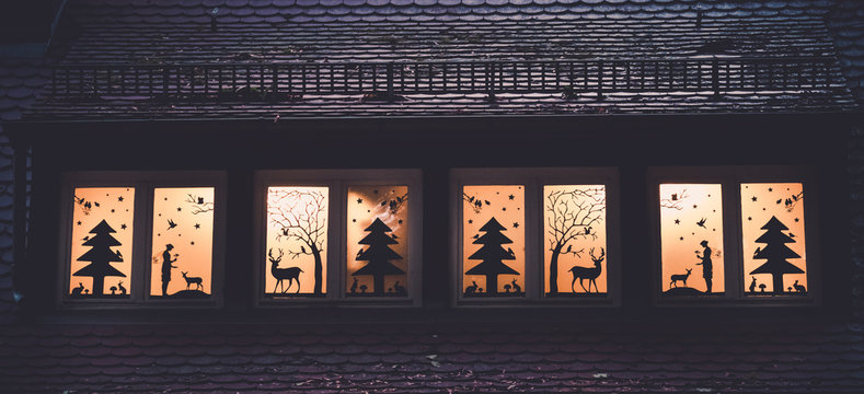 Image of window decoration with forrest fairy tale silhouettes