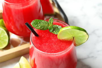 Summer watermelon drink with mint and lime on table, closeup