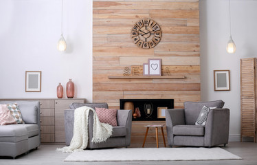 Cozy furnished apartment with niche in wooden wall and armchair. Interior design Fototapete