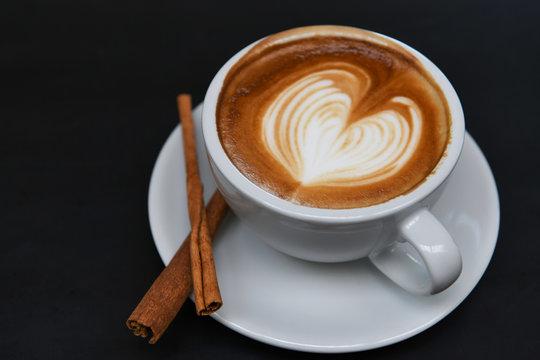 Coffee late heart texture with cinnamon.