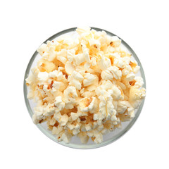 Bowl with delicious fresh popcorn on white background, top view