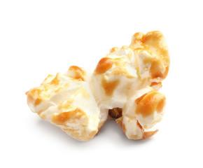 Delicious caramel popcorn on white background
